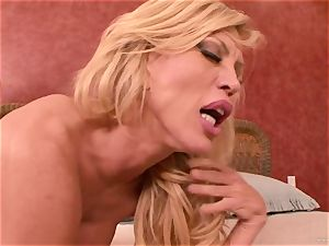 Amber Lynn takes this firm beef whistle deep in her moist crevice