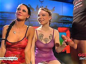 blond and black-haired stunner poked and coated side by side