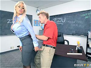 professor Bridgette B gets her student to jizz on her busty baps