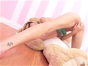 Brett Rossi plays with a jammed bear's strap-on dildo