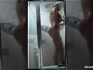 Home movie of Nikita Von James taking a douche