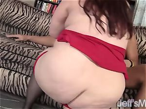 Redheaded plus-size Eliza Allure wanks a ginormous trunk