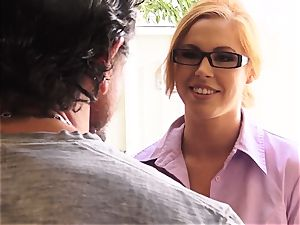 Perfume selling Edyn Blair shows customer how it works