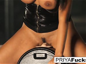 big-titted Priya Rai rails the sybian saddle at the disrobe club