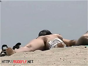 busty bare beach babes filmed by a voyeur