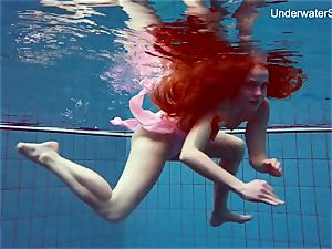red-haired Simonna flashing her figure underwater